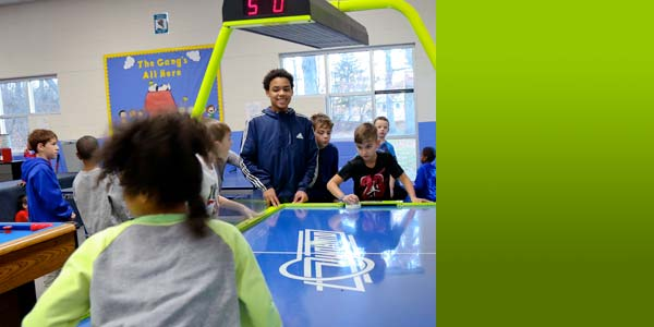Kids Playing Air Hockey