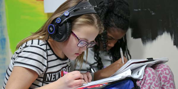 Two Girls Studying and Headphones