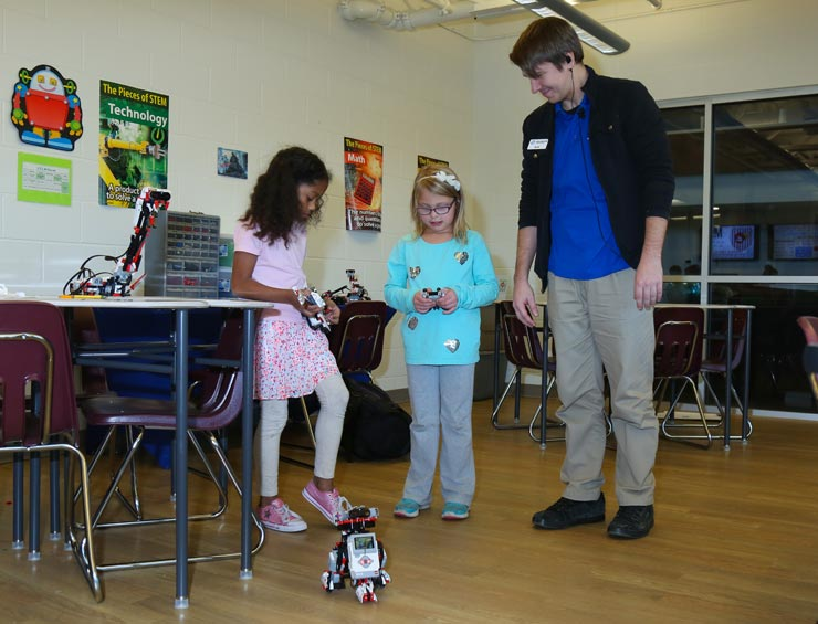 Two Girls Working with Robot