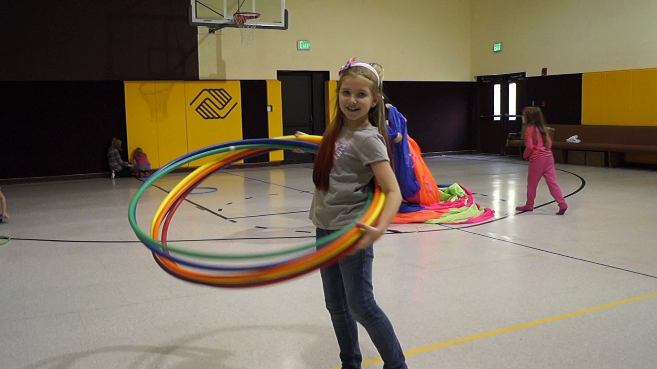 Kid at BGC Having Fun with Hula Hoops