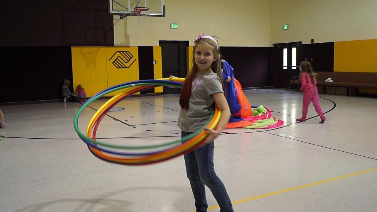 Kid at BGC Having Fun with Hula Hoops